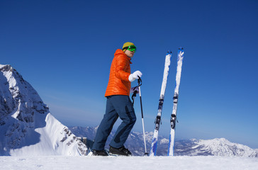 Young man standing alone with ski in snow