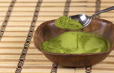 Green matcha powder in a bowl