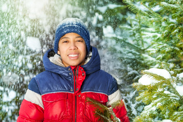 Portrait of boy with green  fir tree brush-wood