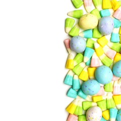 Easter candy border over a white background