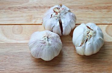 Garlic bulbs on wooden plank