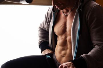 Muscular man body torso, twilight