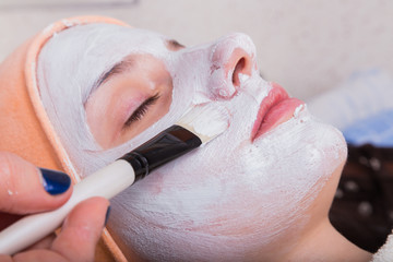 Application of rejuvenating mask on the face