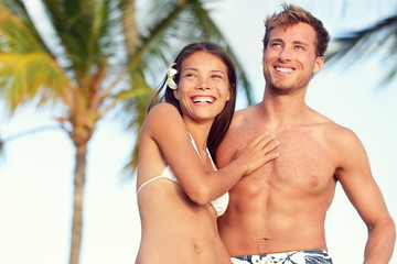Suntan fit body couple beach travel portrait