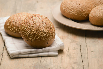 dark bun with sesame seeds