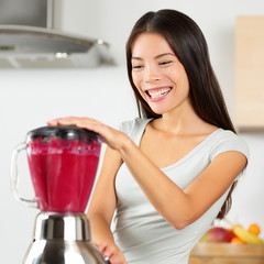 Smoothie woman blending healthy beet - fruit juice