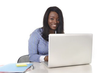happy black african ethnicity woman working at computer laptop