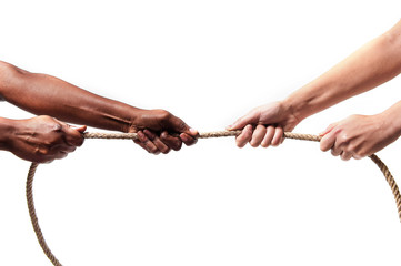 black ethnicity hands pulling rope against Caucasian stop racism