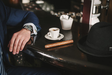 Hands of the groom while wearing watches