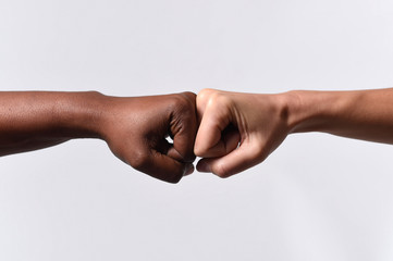 black African American and white Caucasian hands racism concept