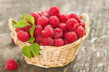 Healthy and fresh raspberries in the basket