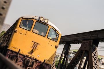 Yellow locomotive on the bridge