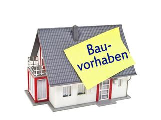 Haus mit Zettel und Bauvorhaben