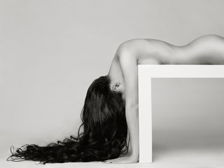 Elegant naked lady with long healthy hair
