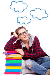 student is sitting with a pile of books on a white background