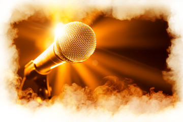 golden microphone on stage with smoke frame