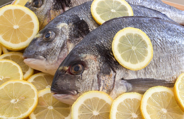 Sea fish with lemon.