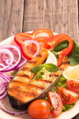 Grilled salmon steak with tomatoes vertical