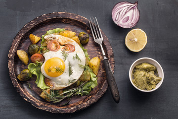 Rustic fried egg and vegetables with fork