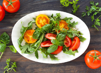 Tomatoes with rocket and basil