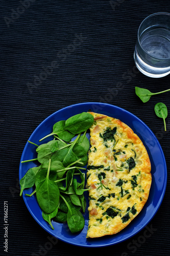 Frittata with chicken and spinach and fresh spinach - 78662271