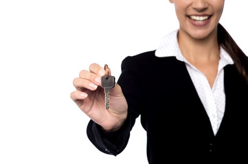 Property agent showing key.