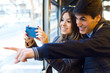 Young couple taking selfies with smartphone at bus. - 78662802
