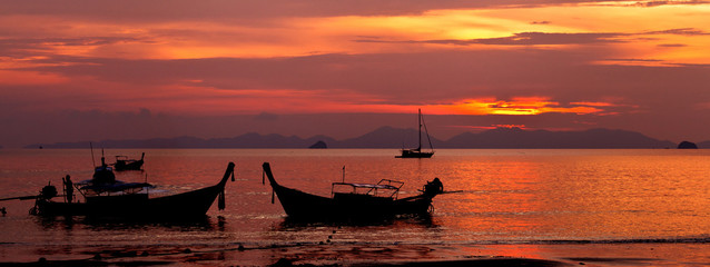 Sunset with boat in Thailand