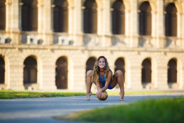 Young professional gymnast with a ball