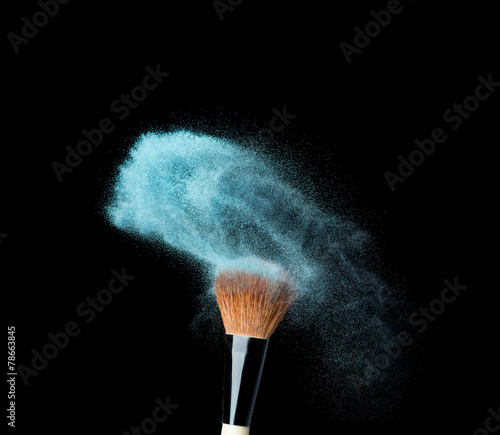 powderbrush on black background with blue powder splash - 78663845