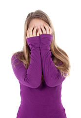 Worried girl covering her face