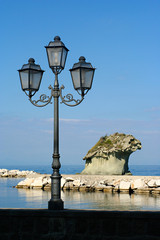 The rock Il Fungo and lantern in Lacco Ameno, Ischia, Italy