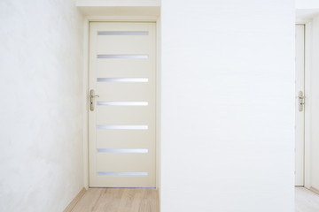 Closed door in bright apartment