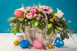 Basket with decorative flowers and colorful Easter eggs (Anemone