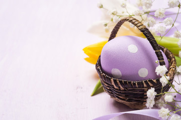 Colorful Easter eggs in a basket. Space for text