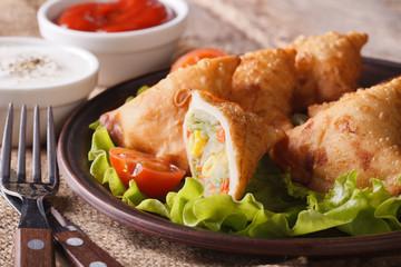 samosa stuffed with vegetables close-up. Horizontal