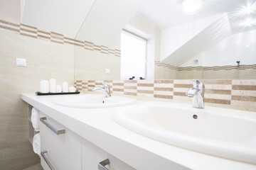 Double sink in the bright bathroom