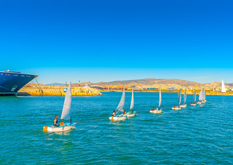 Optimist sailing boats during training at Saronic gulf in Greece
