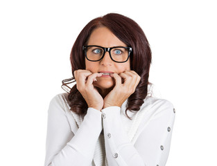 scared anxious woman with glasses biting fingernails