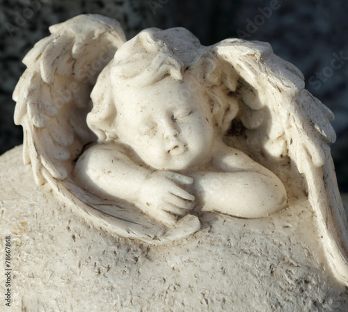sleeping little angel figurine - cemetery tombstone -detail