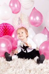 Lovely baby girl with balloons