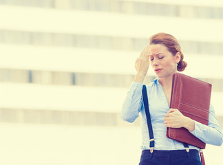 stressed worried unhappy young woman corporate employee
