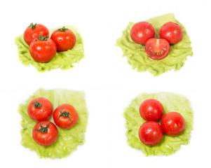 Three tomatoes lying on a sheet of green salad