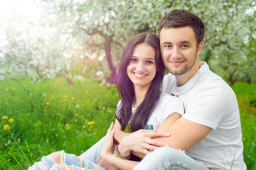 happy young couple in the garden