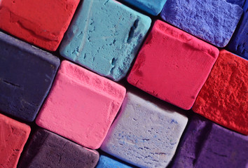 Closeup of bright pastel chalks with red,blue,violet and purple