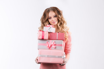 The girl in a pink blouse holding pink boxes