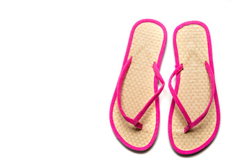 Pink and Straw flip-flop sandalw on a white background