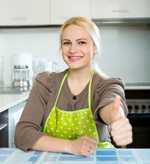 blonde girl staying at kitchen