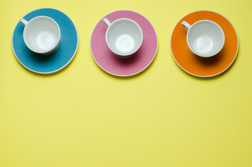 overview of three cups on colorful plates