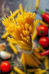 Pasta close-up, ingredients on table